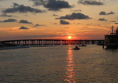 Your evening begins with an unforgettable sunset dolphin cruise near the Destin Harbor.