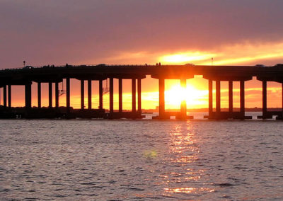 The ever-changing sunset is the backdrop for your dolphin cruise around the Destin Harbor.